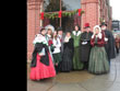 christmas carolers, christmas dresses, victorian dresses, suits